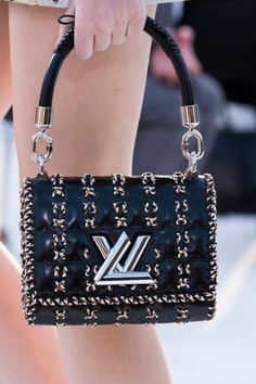 Louis Vuitton - Handbag with Metallic details